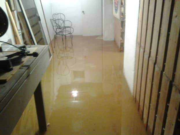 a. Flooding on one side of my basement.
