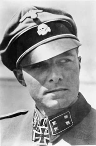 """Colonel Jochim Peiper in his 1st SS Panzer Division """"Leibstandarte"""" Adolf Hitler uniform. The Death's Head insignia on his cap signifies loyalty to the death for the Fuhrer Adolf Hitler. He spoke excellent English."""