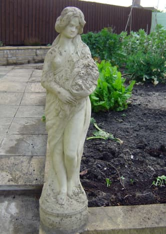 Statue Overseeing Vegetable Garden