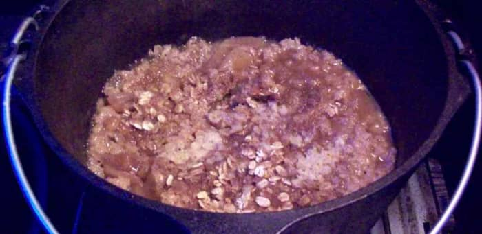 When the apple crisp is cool, it will thicken.  Serve with yummy whipped cream if you like.