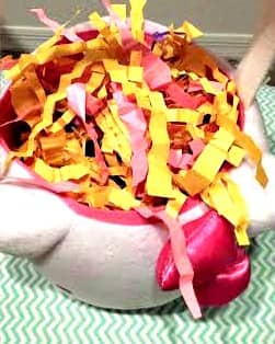 Instead of store-bought Easter grass, use the scraps of paper left from your crafts or newspaper as grass/filler for baskets.  Just crinkle strips by folding them into small folds.