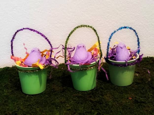 Paint yogurt cups and use pipe cleaners as handles.  Stuff with recycled newspaper or scraps of paper.  You can put Easter eggs and candy inside.