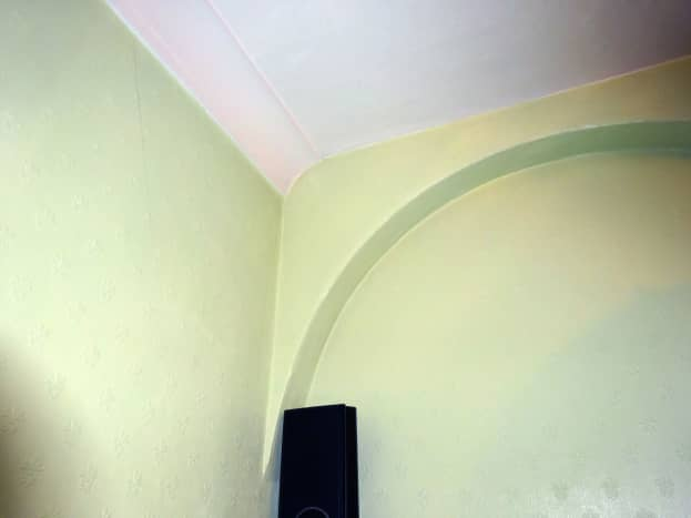 Speaker wires completely hidden behind coving and inside false arch