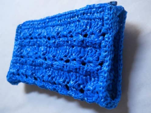 A structural pouch that uses broomstick lace to create interest and ridges in the pattern