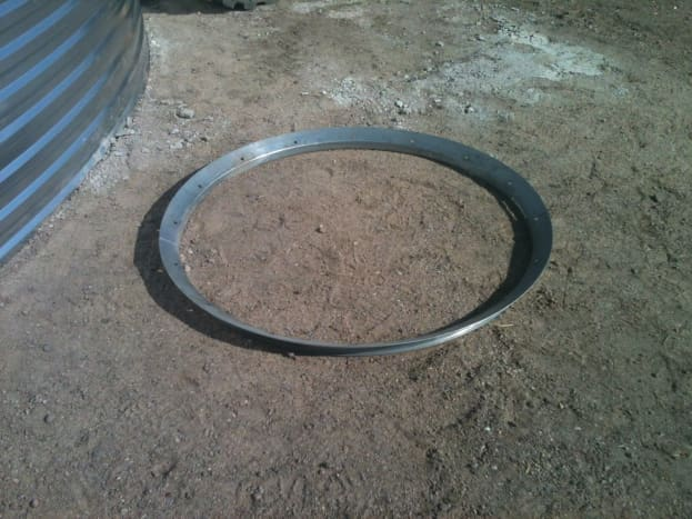 This is the upper peak ring, or collar, prior to installation. No modifications have been made.