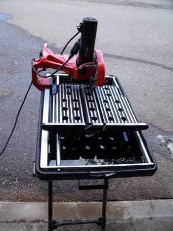 Tile saw used to cut tile.