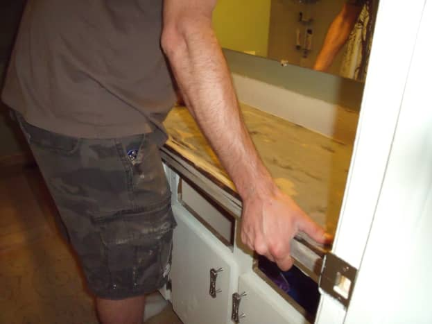 Old countertop is placed back on the cabinets.