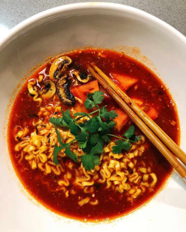 This spicy ramen is delicious! I love the chewy noodles with the spicy broth. I added some tomatoes, and mushroom to the broth.
