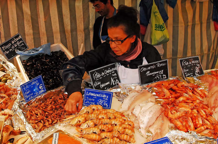 A Stallholder selling her produce