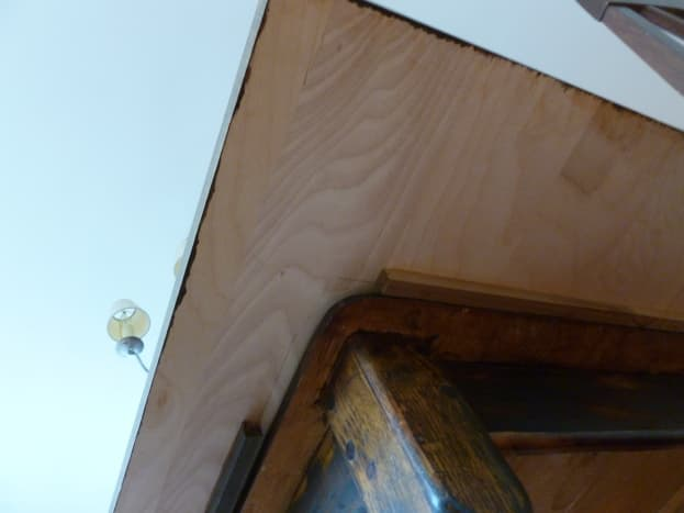 Struts hold the board in place on the old table (viewed from below).
