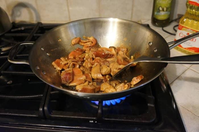 Stir-fry the pork.