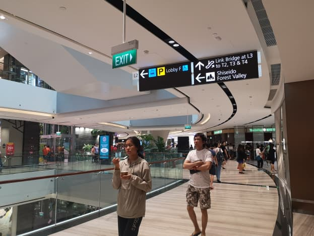 Signboards everywhere showing the direction of the link bridges to T2, T3 and T4.