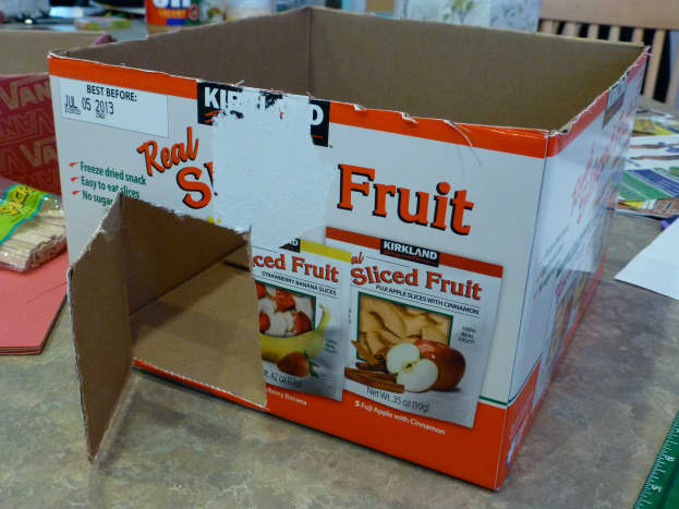 We used an empty snack carton for our sukkah. I cut the flaps off and cut a door in the side.