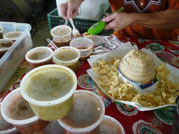 Salsas being sampled at the Farmer's Market at Imperial Sugar Land