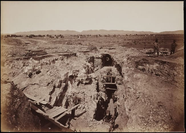 """The """"Old South Shaft Ore Quarry, Face of Tough-nut Mine, part of Town of Tombstone, Arizona. Dragoon Mountains, with Cochise Stronghold in background"""" - Carleton E. Watkins, 1880"""