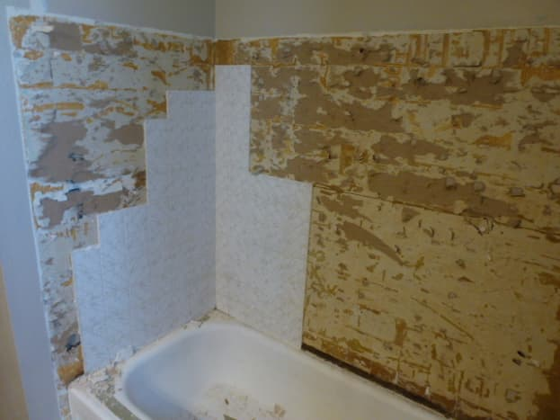 Most of the tile is gone, leaving only some on one end to remove yet.