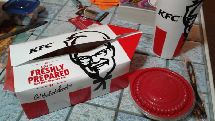 KFC popcorn chicken includes a side and a drink