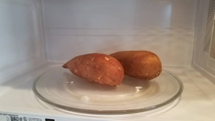 Begin by cooking your sweet potatoes. I chose to cook mine in the microwave for speed, poking fork holes in each of them first for venting.