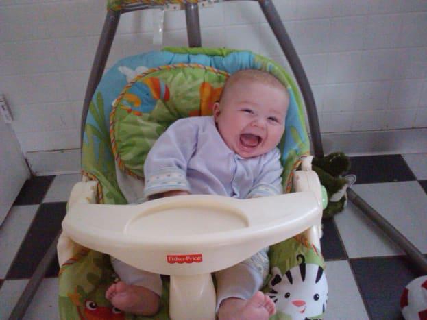 My daughter having fun in her Fisher Price swing!