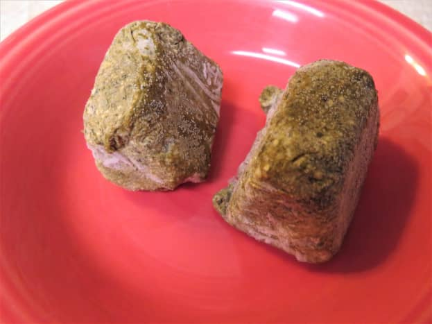Two cubes of pesto taken from the freezer to thaw and use in this recipe
