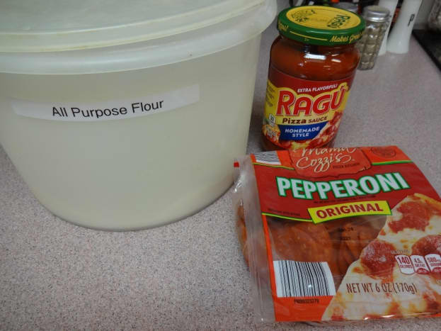 Flour to roll out the dough, pizza sauce for the top, and optional pepperoni for a topping.