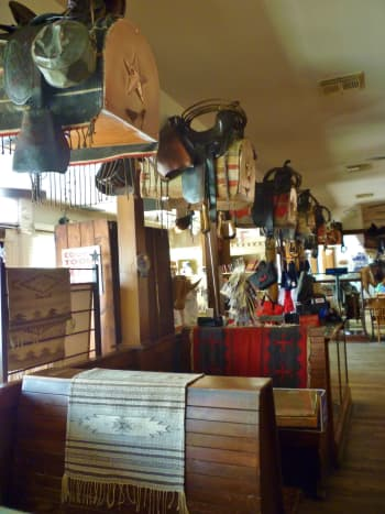 See the saddles above the booths?