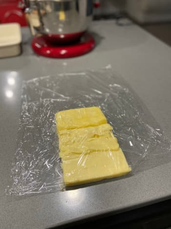 Loosely wrap the butter with plastic wrap.