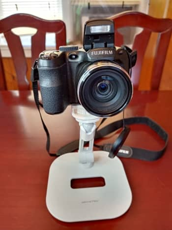 This stand provides a solid but adjustable mounting point for a digital camera