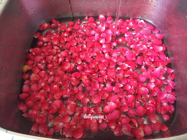 Washing the rose petals.