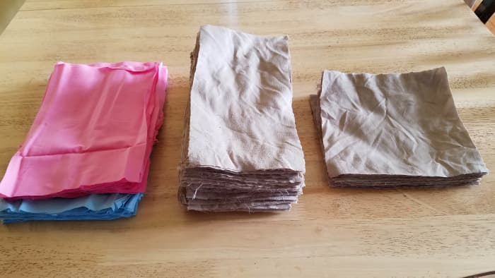 Polyester sheet cut into pieces for making cloth toilet paper.  I made the blue and pink fabric into tissues.
