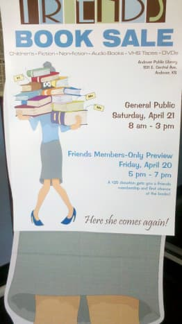 This sign was on a person-sized, cut-out figure (see below). As you walked into the library's lobby, you couldn't miss it. Great advertisement.