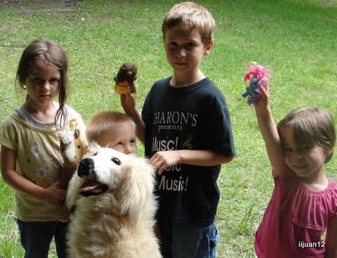 """Waiting outside the door to our back patio with favorite stuffed animal (""""lamb"""") to sacrifice"""