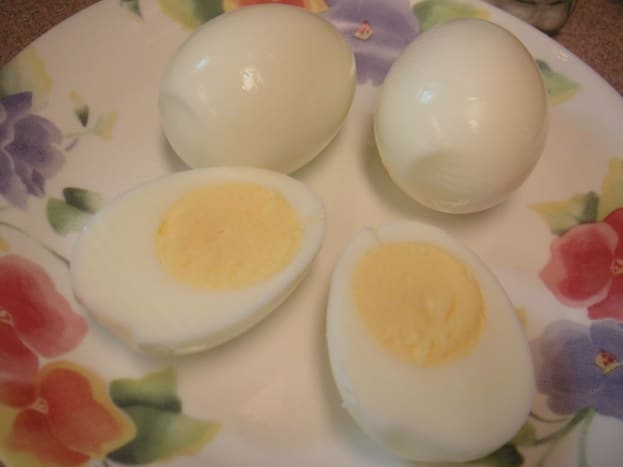 Start by cutting the eggs in half.