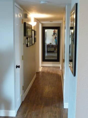 The placement of this mirror reflects right back into the living area. This is a great use of a mirror in a hall to affect feng shui energy.