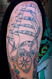A compass can be added to a ship tattoo to symbolize direction or faith.