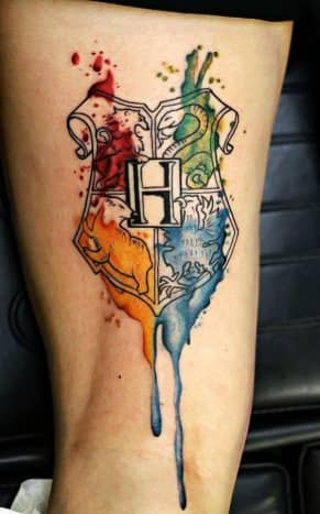 Hogwarts crest watercolour tattoo