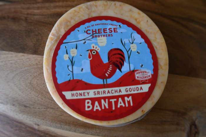 Who doesn't like a cheese package with a giant red chicken on it? Isn't that the stuff of rustic dreams? Or nightmares? Anyway, this Gouda breaks down the door with a kick.