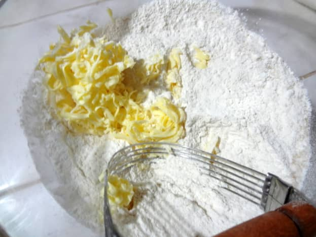 Add grated butter to dry ingredients