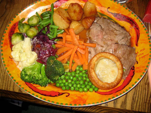 Traditional British Sunday Lunch Roast beef with Yorkshire puddings