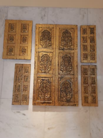 The Taj Mahal hotel has beautifully decorated interiors. Some golden hand crafted doors