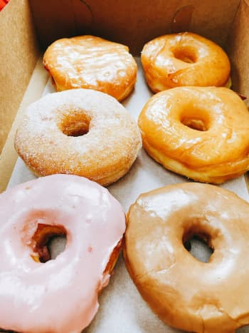 Yummy! There are strawberry glazed, sugar-glazed, maple glazed, raspberry-filled, and sugar donuts in this box.