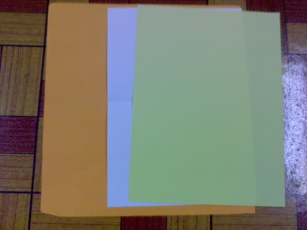 colorful construction papers and white card