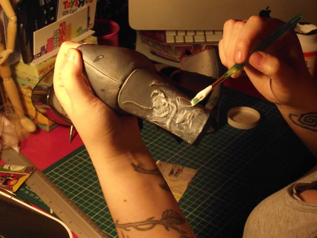 Apply glue to the shoe, then over the image when in place