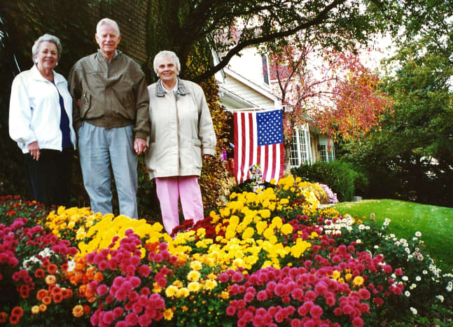 My mother, uncle, and aunt with mum plants in the foreground