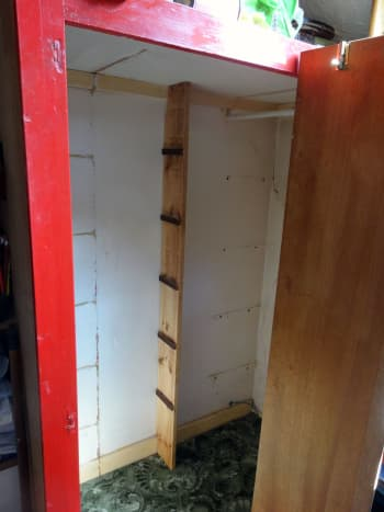 Bookcase side panel wedged into location, ready to fit the shelves.