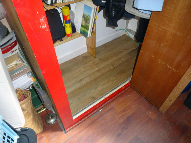 Spare laminated flooring laid in the wardrobe.