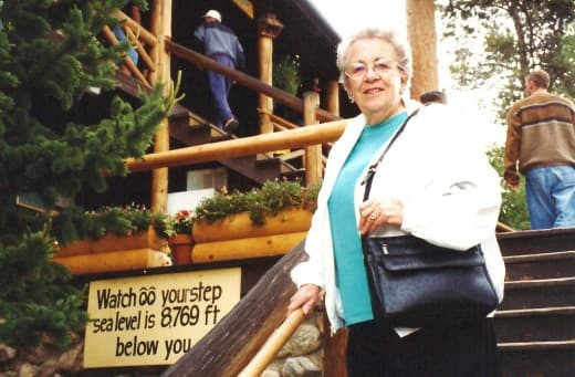 My mother on the stairs at Grand Lake Lodge