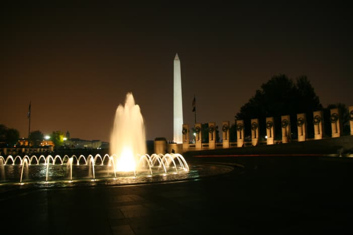 The Washington Monument at night, as seen from the World War II Memorial.