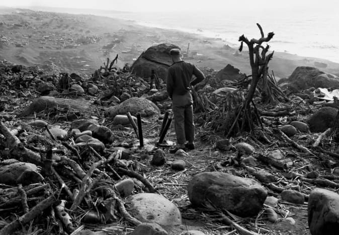 The view from Mount Suribachi on the battlefield below. Instead of marking the end of the battle it signaled the beginning of the deadly battle of attrition to take the island.