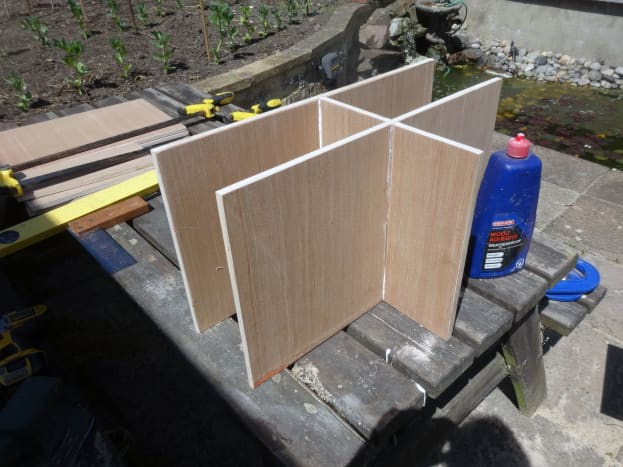 Joining the shelves and middle divider, using the cross halving joints.